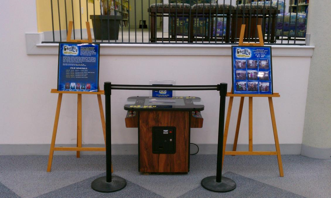 Freeplay 2 promotional display at the Chesapeake Central Library for the March 31st, 2012 event.